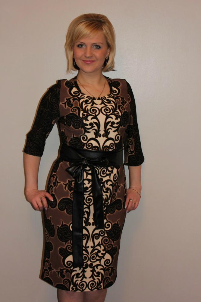 Платье женское ОделияПлатья<br>Пояс в комплекте. Размер: 58<br><br>Принадлежность: Женская одежда<br>Основной материал: Трикотаж<br>Вид товара: Одежда<br>Материал: Трикотаж<br>Состав: 100% полиэстер<br>Длина: 18<br>Ширина: 12<br>Высота: 7<br>Размер RU: 58