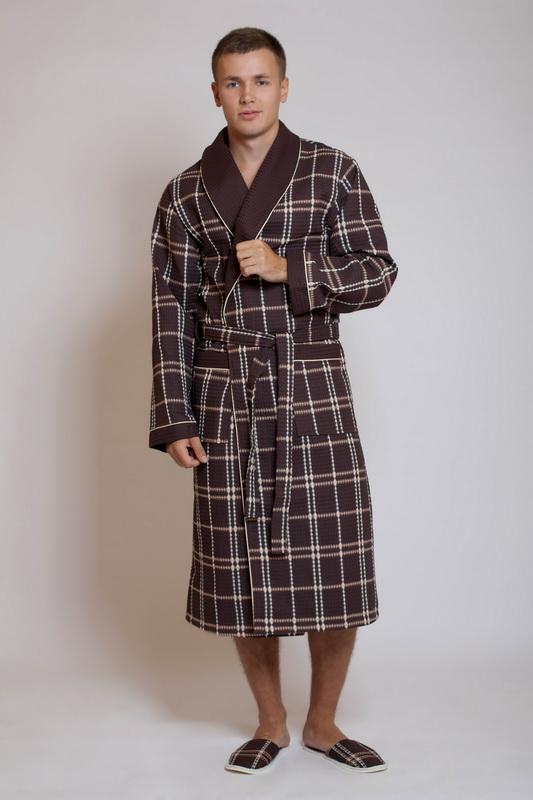 Халат мужской ТандемТеплые халаты<br>Домашний халат &amp;amp;mdash; вовсе не привилегия слабого пола, халаты для мужчин также очень популярны. Мужской халат Тандем из вафельного полотна сразу вызовет симпатию и доверие у сильного пола.<br>Данный халат действительно выглядит по-мужски: не только благодаря модной расцветке в клетку, представленной в разных вариациях, но и за счет классического запашного фасона. Длина ниже колена делает его очень удобным и практичным &amp;amp;mdash; вы можете надевать халат после ванны или просто придя с работы.<br>Качество и цена мужского халата Тандем не огорчат Вас &amp;amp;mdash; они настолько удачно гармонируют друг с другом, что создают просто идеальный тандем для покупателя! Размер: 56<br><br>Принадлежность: Мужская одежда<br>Основной материал: Вафельное полотно<br>Вид товара: Одежда<br>Материал: Вафельное полотно<br>Состав: 100% хлопок<br>Длина: 30<br>Ширина: 20<br>Высота: 11<br>Размер RU: 56