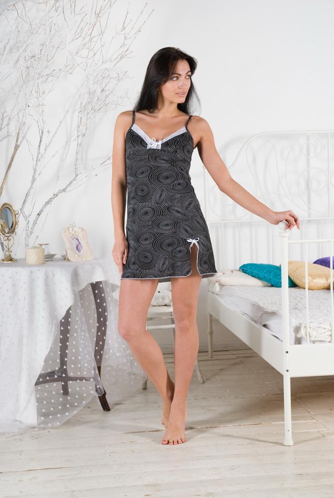 Ночная сорочка ЛотосСорочки и ночные рубашки<br>Вы - любительница элегантных, женственных и изящных силуэтов? Стремитесь всегда оставаться неотразимой, стильной и привлекательной? Не отказывайте себе! Ваш выбор - ночная сорочка Лотос.<br>Тонкая кулирка - оптимальный материал для пошива одежды для сна. Особая ткань не парит, не прилипает к телу, не способствует перегреву и позволяет чувствовать себя легко в сильную жару. Натуральной хлопковое волокно подходит аллергикам и чувствительной коже. Кулирка гигроскопична, так что хорошо поглощает влагу, после чего быстро сохнет.<br>Еще одно явное преимущество ночной сорочки Лотос - доступная цена. В наличии - разные размеры.  Размер: 50<br><br>Принадлежность: Женская одежда<br>Основной материал: Кулирка<br>Страна - производитель ткани: Россия, г. Иваново<br>Вид товара: Одежда<br>Материал: Кулирка<br>Состав: 100% хлопок<br>Длина рукава: Без рукава<br>Длина: 18<br>Ширина: 12<br>Высота: 7<br>Размер RU: 50