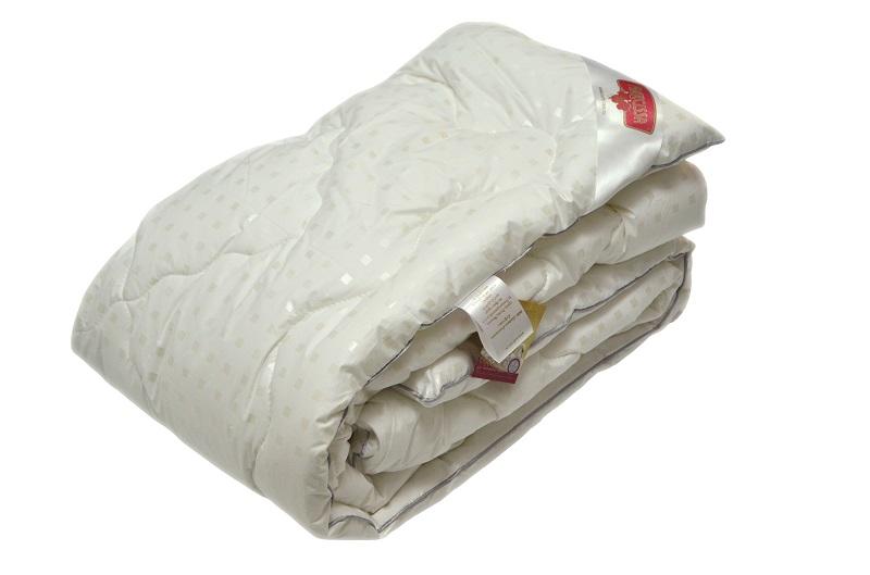 Одеяло зимнее Уют (лебяжий пух, тик) 2 спальный (172*205)Лебяжий пух<br>Проблема многих пуховых одеял состоит в том, что со временем практически весь пух вылезает наружу, а само одеяло становится таким тонким, что уже ни для чего не годится.   Чего-чего, а этого с одеялом NARCISSA Лебяжий пух точно не случится! Все дело в том, что его чехол сшит из сверхпрочного тика, через волокна которого не пролезет даже самое маленькая и пушинка, не говоря уже о перьях. Во многом другом данное одеяло ни в чем не уступает другому пуховому одеялу - оно такое же легкое и воздушное.  Данное одеяло предназначено для зимы, поэтому не ждите наступления холодных зимних ночей, а начинайте думать о покупке теплого зимнего одеяла уже сейчас! <br>Размеры:<br>Детское (110*140) 1,5 спальное (140*205) 2 спальное (172*205) Евро-1 (200*220) Евро-2 (220*240) Размер: 2 спальный (172*205)<br><br>Высота: 20<br>Размер RU: 2 спальный (172*205)