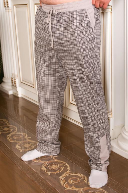 Брюки мужские МарионДомашние брюки<br>Хлопковые брюки &amp;amp;mdash; не просто важный, но необходимый элемент мужского гардероба. Они становятся идеальным вариантом на жаркий летний период, когда даже самые легкие джинсы заставят вас попотеть &amp;amp;mdash; в прямом смысле слова! В то же время, тонкие хлопковые брюки отлично подходят для дома, где одежда должна быть максимально комфортной. И если сейчас вы в поисках своих идеальных брюк, обратите внимание на модель Марион.<br>Изделие выполнено из качественной кулирки, в составе которой &amp;amp;mdash; стопроцентный хлопок. Ткань отлично пропускает воздух, впитывает влагу и не вызывает ни малейшего дискомфорта. Немаловажную роль играет и дизайн брюк: классическая клетка делает вещь одновременно стильной и уютной. Одноцветные вставки на поясе и по низу штанин завершают общее цветовое решение модели.<br>Мужские брюки Марион могут стать как комфортабельным домашним нарядом, так и вполне удачным выбор для поездки на море или простой прогулки. А хорошее качество и приемлемая цена делают данную модель еще более выгодной покупкой. Размер: 50<br><br>Высота: 9<br>Размер RU: 50