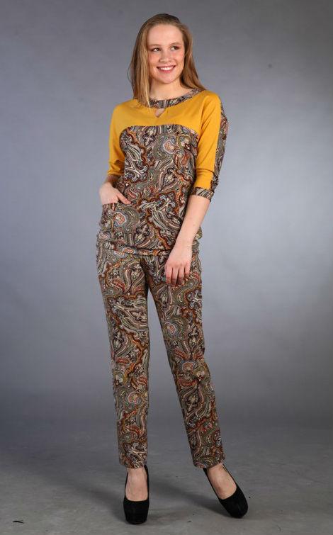 Костюм женский АминтаЗимние костюмы<br>Костюм женский. Блуза - рукав, покрой «кимоно» 3/4, передняя половинка рукава из отделочной ткани, печать «Роза». Брюки длинные. Размер: 44<br><br>Принадлежность: Женская одежда<br>Комплектация: Брюки, блузка<br>Основной материал: Вискоза<br>Страна - производитель ткани: Россия, г. Иваново<br>Вид товара: Одежда<br>Материал: Вискоза<br>Тип застежки: Без застежки<br>Состав: 100% вискоза<br>Длина рукава: Средний<br>Длина: 30<br>Ширина: 20<br>Высота: 11<br>Размер RU: 44