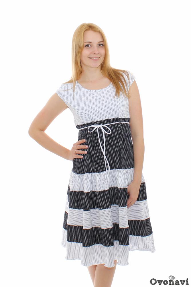 Платье женское АмелияПлатья<br>Женское платье, предназначенное для повседневной носки, должно быть не только красивым и стильным, но и совершенно удобным, и не доставлять никакого дискомфорта. Именно этим требованиям полностью соответствует платье Амелия.<br>Изделие имеет стильную контрастную расцветку. Классический черно-белый тандем в сочетании с игривым узором в горошек делают модель универсальной. Она подойдет как взрослым женщинам, так и совсем юным девушкам. Стоит отметить и фасон: легкая расклешенная юбка длиной ниже колена и короткие рукава - отличный вариант на жаркий летний день. Тоненькие завязки под грудью добавляют платью игривости и женственности.<br>Платье Амелия сшито из кулирки, которая, как известно, состоит их стопроцентного хлопка. Нежная ткань бережно прилегает к коже, не вызывает аллергии, раздражения и любых других неприятных ощущений. Широкий размерный ряд позволит подобрать наряд на любую фигуру.<br>В этом платье вы будете чувствовать себя легкой, изящной и неповторимой! Размер: 52, Бело-чернильный<br><br>Длина платья: Миди<br>Производство: Производится про запас<br>Принадлежность: Женская одежда<br>Основной материал: Кулирка<br>Страна - производитель ткани: Россия, г. Иваново<br>Вид товара: Одежда<br>Материал: Кулирка<br>Сезон: Лето<br>Тип горловины: Круглый вырез<br>Обработка: Горловина и рукава обработаны окантовкой в 2,5 см<br>Тип рукава: Втачной<br>Другие особенности: Завязка под грудью, расклешенная юбка сшита из нескольких деталей<br>Состав: 100% хлопок<br>Обработка низа: Декоративная строчка<br>Длина рукава: Короткий<br>Длина: 18<br>Ширина: 12<br>Высота: 7<br>Размер RU: 52, Бело-чернильный